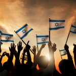 Group of People Waving the Flag of Israel